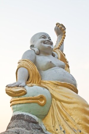 Statues of Buddha a happy laughing buddha s face in China  photo