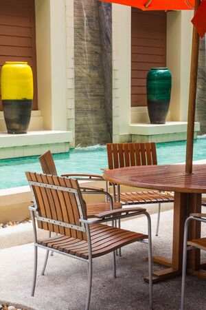 Poolside loungers at hotel  Stock Photo