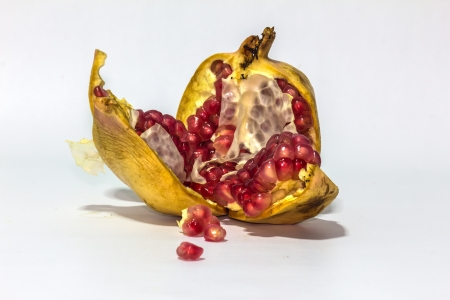 background of a red pomegranate fruit seeds