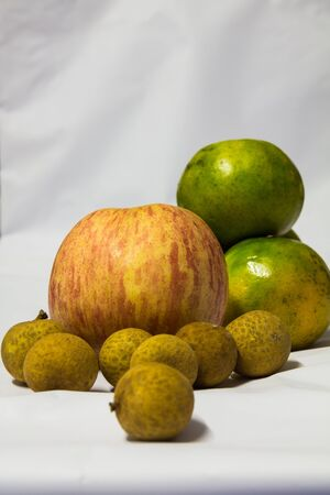 Many fruits on white background