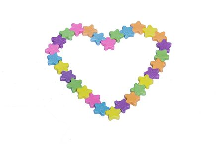 Conversation Hearts in the Shape of a Heart on a white background