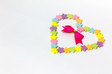 Candy hearts red ribbon on a white background