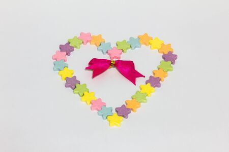 Candy hearts red ribbon on a white background  photo