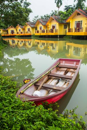 Yellow and red boat house resort  Stock Photo