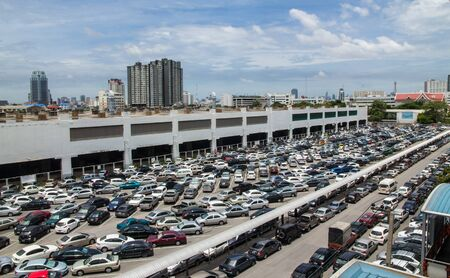 High angle view, crowded parking and skyscrapers in the city, Bangkok. Stock Photo