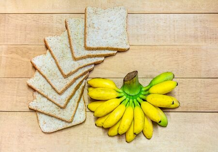 wood floor: Pounds of Bread, Healthy Banana, Healthy on background wood floor