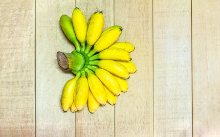 wood floor: Close up of Golden banana ripe on wooden floor, agriculture Stock Photo