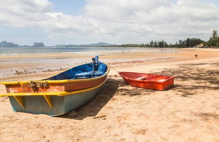 Landmark and two thai boats on sand, South of Thailand. Stock Photo