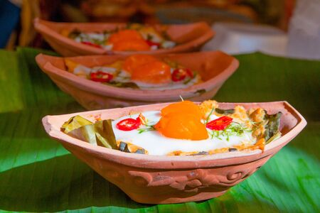 Steamed fish with curry paste in earthenware