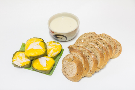 Bread cereal, soy milk , and Khanom Thai desserts  on a white background.