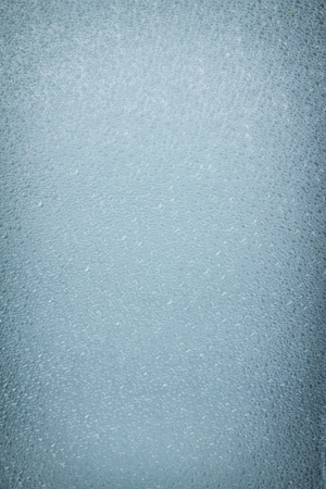 Frosted glass window, light blue color background  for decorative works or texture