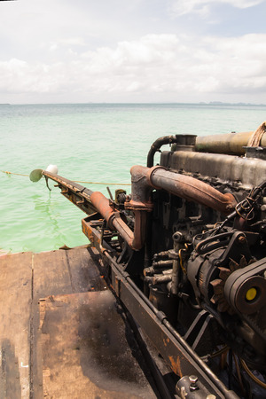 Close up detail of Long tail boat old engine, obsolete Technology concept Stock Photo