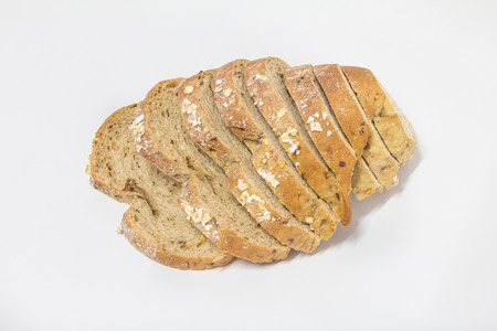 Cereal bread mixed with white sesame seeds, sprinkled with sliced oats.