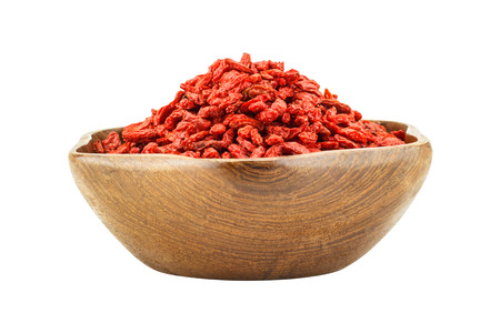 lycium: Red dried goji berries  Lycium Barbarum - Wolfberry  in wooden bowl isolated on a white background