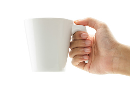 Hands holding a cup of coffee isolated on white background photo