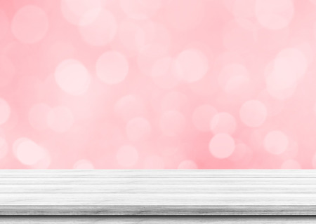 Empty white wood table top on blurred pink bokeh lights background, Used for display or montage your products. Standard-Bild