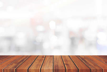 Empty wooden table top on gray blur abstract background from inside shopping mall,Used for display or montage your products 免版税图像