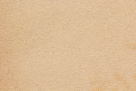 Brown paper background. Empty cardboard texture. Craft sheet