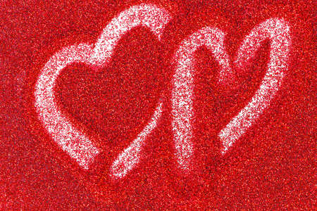 Red glitter background with a heart drawn a finger. Valentines day background