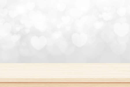 Empty wooden deck table on white background with heart shape. Valentines day concept Standard-Bild - 163189695