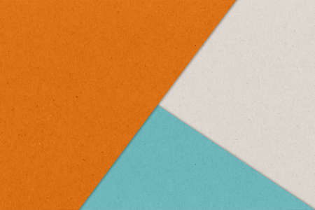 Kraft paper sheet overlap with orange, blue and gray colors for background Standard-Bild - 163190296