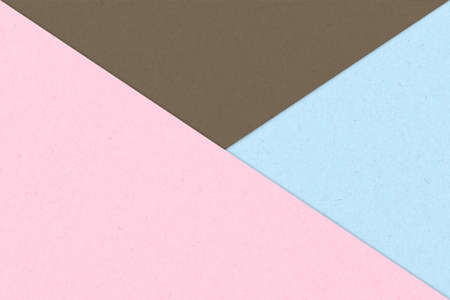 Kraft paper sheet overlap with pink, blue and brown colors for background Standard-Bild