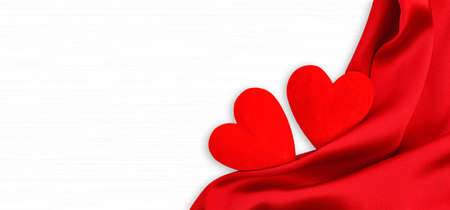 Wooden white background with red hearts and red satin. Concept of valentine day.