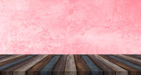 Empty brown wood table top on pink loft wall background. Template mock up for display of product