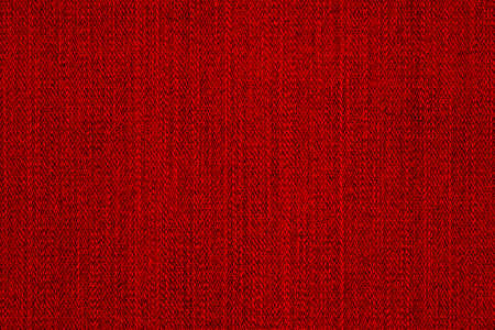 Close up of a red fabric textile background