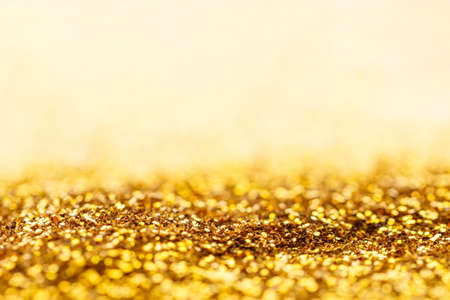 Gold glitter sparkle bokeh light background