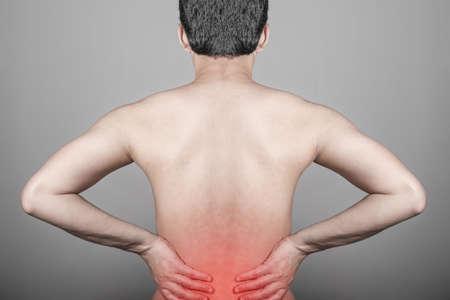 Man feeling lower back pain