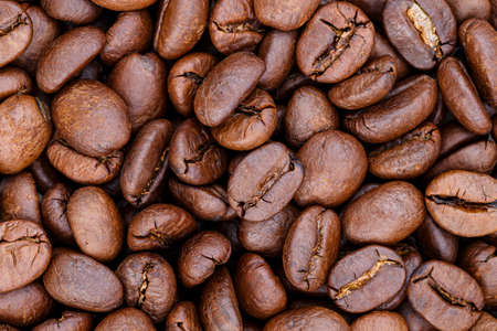 Roasted coffee beans for background Фото со стока