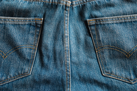close up two back pockets of denim blue jeans Stock Photo