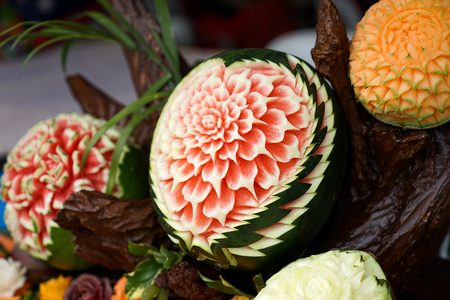 Beautifully Thai Hand carved fruits In Flower pattern.