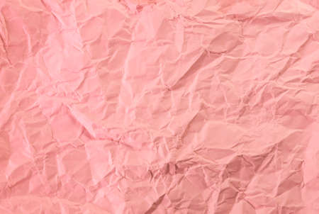 crumpled pastel soft orange color paper background.