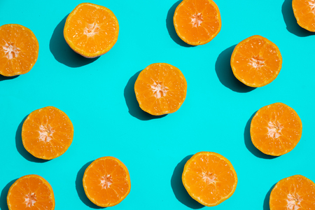 Top view fresh orange slices on bright blue background. . Copy Space. creative summer concept. Half of citrus in minimal, Banner
