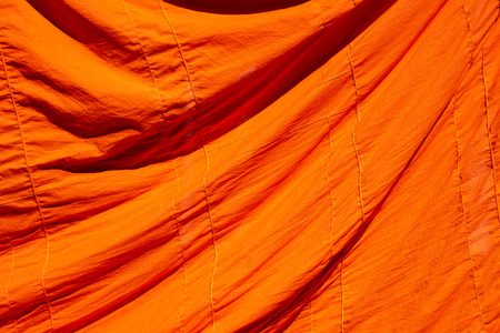 texture of orange robe of a buddhist monk or novice for background Imagens