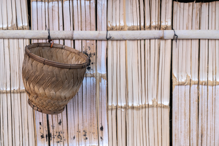 sticky rice steamer basket hang on bamboo wall