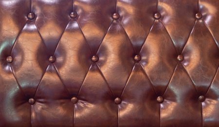 drak red Upholstery artificial leather with rivets Imagens