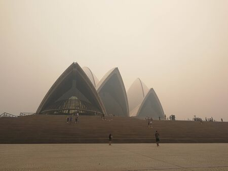 smoke haze over The Opera House from uncontrolled bush fire in Sydney, Australia : 10122019
