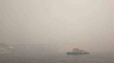 invisible Sydney harbor bridge in the smoke haze, from bush fire in NSW, caused Sydneys air quality plummet.  Australia :10-12-2019
