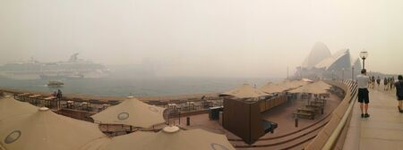 panorama of invisible Sydney opera house and harbor bridge in the smoke haze, from bush fire in NSW, Australia :10-12-2019 Editorial