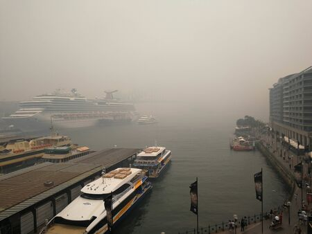 circular quay and Sydney harbor were covered by bush fire smoke haze in the afternoon, caused Sydneys air quality plummet. Australia: 10-12-2019