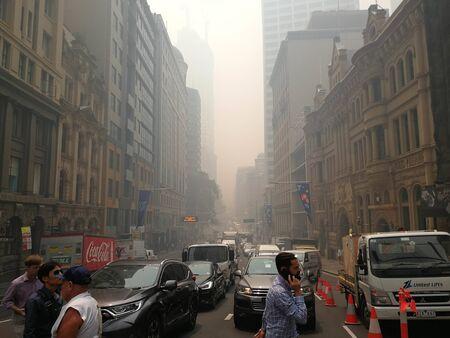 Smoke haze covered over business buildings in city from uncontrolled bush fire, caused Sydneys air quality plummet, Australia : 10122019