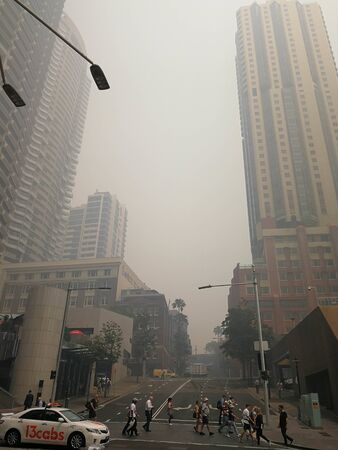 Smoke haze covered over business buildings in city from uncontrolled bush fire, caused Sydney's air quality plummet, Australia : 10/12/2019 Editorial