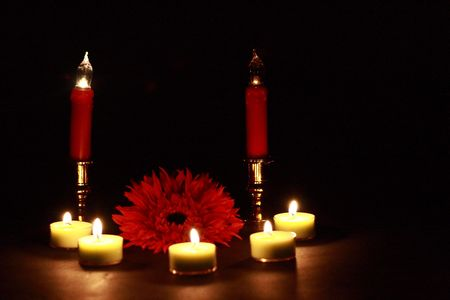 Red Flower Surrounded by Candles
