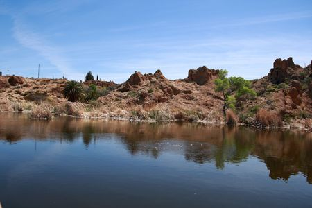 Water with Rock Formation Background
