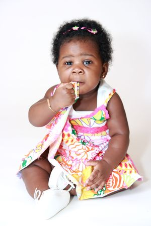 Baby Girl Chewing on Dress
