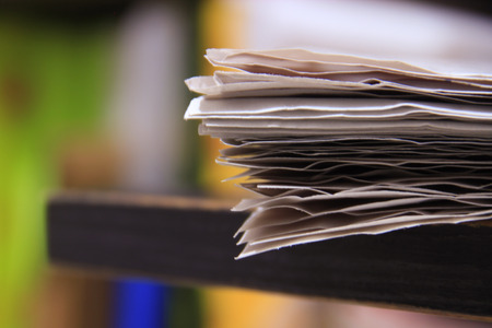 loosely: Close up of paper stacked together loosely  on a table