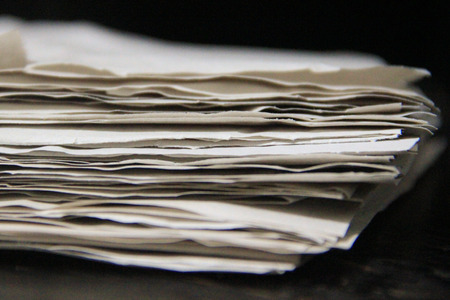 loosely: Close up of paper stacked together loosely